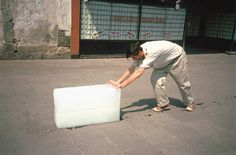 Francis Alÿs (born 1959) charges into a tornado kicking up swirls of dust with a hand-held camera. He pushes a huge block of ice around the streets of Mexico City?