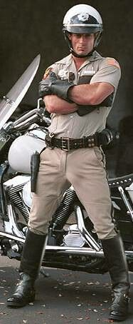 Motorcycle officer in stance position.