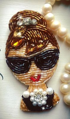 Audrey Hedburn Looks like her alot! Bead Embroidery Jewelry, Beaded Embroidery, Beaded Jewelry, Jewellery, Lesage, Passementerie, Beaded Animals, Beaded Brooch, Embroidery Fashion