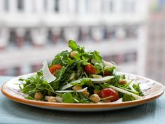 Wild Arugula and Chickpea Salad from FoodNetwork.com-skip the cheese or use sparingly for taste...