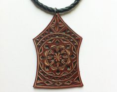 Carved leather pendant leather jewelry by DIONESAMBROZIUS on Etsy