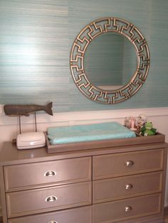 Love this simple look for a changing table - it will transition so well into a kids room and beyond!