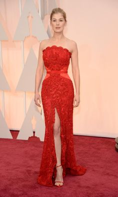 "Rosamund Pike may have found herself on the worst dressed list time and time again this awards season, but the ""Gone Girl"" star had arguably one of the best looks of the evening when she donned an absolutely ravishing red Givenchy gown at the 87th Academy Awards on Feb. 22, 2015."