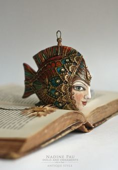 "Nadine Pau ""Golden Fish"" Christmas ornaments. Papier mache, oil patina varnish. Sold. #christmasornaments #nadinepau"