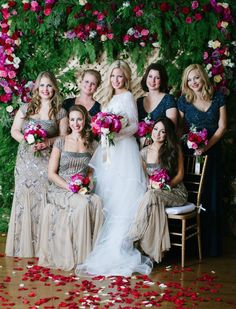 bridal party in front of floral backdrop