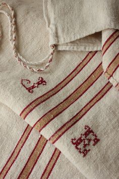monogramed and lovely mustard yellow and red grain sack