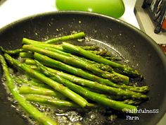 Garlic Butter Asparagus ~ 2 to 3 Tbsp butter 2 to 3 cloves garlic, minced 1 lb. asparagus, trimmed Olive oil to taste Salt and pepper to taste Melt butter in a skillet over medium heat. Add garlic and asparagus. Cook for about 10 minutes, until crisp-tender. Just before removing asparagus from skillet, drizzle with olive oil. Drain asparagus on paper towel, if desired. Add salt and pepper to taste. Serves 4.