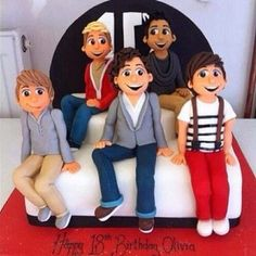 A One Direction Cake I want one for my birthday !