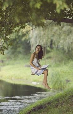 The art of living. Beautiful Swing Reading by the River! Such a majestic sight!! <3