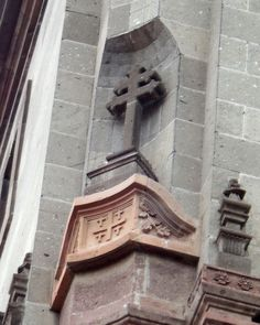 A cross built into the building at the Parroquia.