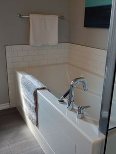 Home staging tip: Declutter! Then add fresh white towels to your bathroom when you're trying to sell your house.