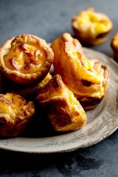 NYT Cooking: These diminutive egg tarts — pasteis de nata — a specialty all over Portugal, have a cinnamon flavored custard nestled in a flaky puff pastry crust. The trick here is to… Tart Recipes, Dessert Recipes, Cooking Recipes, Easter Recipes, Cooking Videos, Egg Recipes, Egg Custard Tart Recipe, Custard Desserts, Portuguese Egg Tart