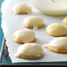 Iced Orange Cookies Recipe -I usually make these bite-size cookies at Christmastime, when oranges in Florida are plentiful. Every time I sniff their wonderful aroma, I remember my grandmother, who shared the recipe. —Lori DiPietro, New Port Richey, Florida