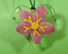 Unique glass art by LeavesOfGlassArt on Etsy Pink Plumeria tack-fused to heart-shaped base. Stained Glass Art, Fused Glass, Suncatchers, Tack, Heart Shapes, Art Projects, Etsy Seller, Leaves, Create