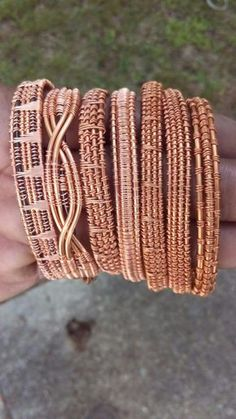 This is an excellent study in different wraps with the final result being a full. - This is an excellent study in different wraps with the final result being a full bangle set. I woul - Copper Wire Jewelry, Handmade Wire Jewelry, Copper Bracelet, Gold Wire, Leather Jewelry, Wire Crafts, Jewelry Crafts, Maille Viking, Wire Wrapped Bracelet