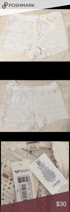 "ROXY Sand Dollar Crochet Cover-up shorts w/tassel Roxy - Sand dollar crochet cover-up shorts w/ tassel detail. New With Tags. Retail $48.00. Purchased at Dillard's. Size: Medium. Rather than covering you up, these crochet shorts are designed to playfully showcase your bikini bottoms. Tassels dangling from the ruffled, drawstring waist sweeten the final look. 2"" inseam; 24"" leg opening; 10"" front rise; 12"" back rise (size Medium). 100% cotton. Machine wash cold, tumble dry low. By Roxy…"