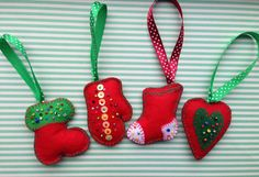 Set of 4 beautiful felt Christmas ornaments - two boots, a glove and a glove. These felt ornaments are hand embroidered and hand stitched. Will make