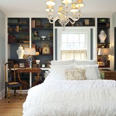 cozy guest room with bookshelf wall