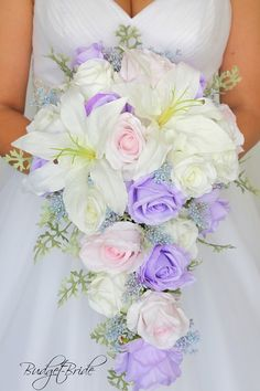 Prettiest spring wedding ideas---Cascading purple/lilac and white roese and lilies bouquets, diy bridal bouquets on a budget. Prettiest spring wedding ideas---Cascading purple/lilac and white roese and lilies bouquets, diy bridal bouquets on a budget. Cascading Wedding Bouquets, Cheap Wedding Flowers, Lilac Wedding, Wedding Flower Arrangements, Bridal Flowers, Flower Bouquet Wedding, Blush Bouquet, Lavender Wedding Colors, Bouquet Flowers