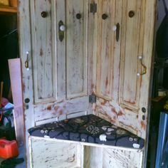Dad and I made this coat rack/bench out of two old farm house doors, vintage door knobs and hooks. Yay for upcycling!