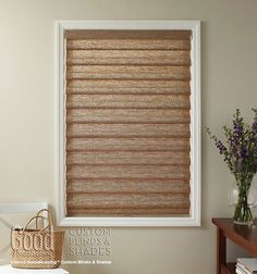 Adding natural and earthy elements to your home will create a relaxing environment. Keep in simple and classic with natural woven roman shades.