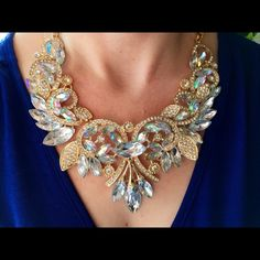Iridescent Formal/Prom Crystal Statement Necklace Stunning gold and crystal necklace with slight murkiness in one of the stones on the left side of the picture that is difficult to spot as the stones are so shiny. Otherwise in pristine condition. Accessories