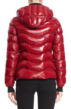 Free shipping and returns on Moncler 'Anthia' Water Resistant Shiny Nylon Hooded Down Puffer Jacket at Nordstrom.com. A fitted, fashionably cut coat in durable, water-resistant nylon stands out on the slopes or streets thanks to its wavy channel quilting and liquid-shine finish. Premium down-and-feather insulation locks in body heat without added bulk, while a tall, scuba-style hood offers added protection against frigid temperatures.