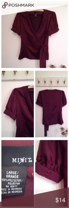 "Sweet short sleeve wrap look blouse by Mix-it size Cute short sleeve blouse  Feels like silk Cute puff sleeve Faux wrap with ribbon  ties Side zipper  Burgundy  Label:  Mix-it.    Polyester.   Size large  Great condition  40"" Bust 34"" Waist Mix It Tops Blouses"