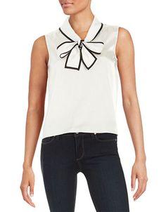 """<ul> <li>A tie-front charms contrast-trimmed satin blouse</li>  <li>Fold-over collar</li>  <li>Attached bow tie</li>  <li>Sleeveless</li>  <li>Slight shirring at shoulders</li>  <li>Back yoke</li>  <li>About 22"""" from shoulder to hem</li>  <li>Polyester/spandex</li>  <li>Dry clean</li>  <li>Imported</li>  </ul>"""