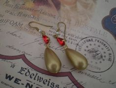 Ruby-red vintage glass pear-drop rhinestones set with vintage matt-gold pendant charm