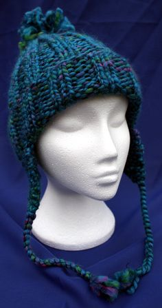 Hand knitted woolly earflap hat with bobble in attractive 'Majestic Blue'. Handknit hat. Knit hat. Wool hat Earflap hat with braids / plaits