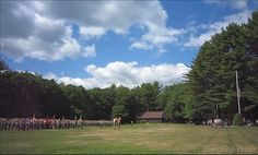 The flag is lowered on August 24, 2014, at the Week 8 Sunday Dress Parade, bringing #Yawgoog's 99th season to a close.  Image taken at Tim O'Neil Field by David R. Brierley.
