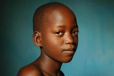 Benin, 2006: Samsung, a 12-year-old orphan, sits in the home of his caretaker in Porto Novo, the capital. Orphans are highly vulnerable to abuse, exploitation and trafficking; in 2006, over 40,000 children in Benin were victims of trafficking. Today, there are over 34,000 orphans in the country. UNICEF supports programmes to shelter, educate and provide vocational training to orphans and other vulnerable children.  - © UNICEF/Julie Pudlowski - More info: http://www.unicef.org/