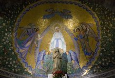 This mosaic image of Our Lady of Lourdes forms the apsidal backdrop to one of the outdoor chapels in the Rosary Square of the Lourdes shrine. Today, 11 February, is the feast of Our Lady of Lourdes.