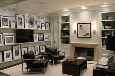 I love this family room with the shelves on the wall, mounted TV and black & white art!