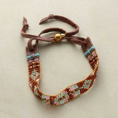 Adonnah Langer hand looms Czech and Japanese seed beads with touches of brass. Sliding copper bead adjusts leather laces. Sundance exclusive...