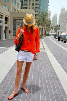 white shorts orange blouse fedora