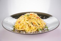 Spaghetti Aglio e Olio (by Mario Batali)  Salt and Pepper 1 1/2 pounds Spaghetti 1/2 cup Extra Virgin Olive Oil 3 Garlic cloves (sliced thinly)  1 tablespoon Red Chili Flakes  3/4 cup Pickled Cherry Peppers 1/2 cup Flat-Leaf Parsley Fat Boy Bread Crumbs