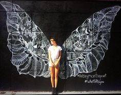 New York City Street Artist @KelsMontagueArt is Painting a Major Mural Project in Downtown Summerlin, Las Vegas (Pictured: Taylor Swift poses with wings entitled What Lifts You?).