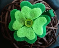 shamrock hair clip. i just happen to have green felts and alligator clips and a SUPER CUTE NIECE with long hair :)