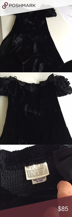 Moda International sz 6 off shoulder velvet dress Moda international size 6 black off shoulder velvet dress! This is a cap off the shoulder sleeve which is super trendy right now! Beautiful velvet. Gently worn but great condition! Moda International Dresses