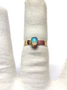 Metal : Yellow Gold Metal Carat : 14K Ring Size: US 5-US 12 Band Width : 3 mm Gemstone Size : 5 x 7 mm Oval Gemstone : Natural Ethiopian Opal Weight : 2 - 3.2 gm #opalband #goldopalband #opalring #goldopalring #ethiopianopal #ethiopianopalring #ethiopianopalband #14kgoldopalband Thick Wedding Bands, Gold Wedding Rings, Gold Rings, Opal Band, Opal Rings, Christmas Jewelry, Handmade Christmas, Christmas Gifts, Couples Ring Tattoos
