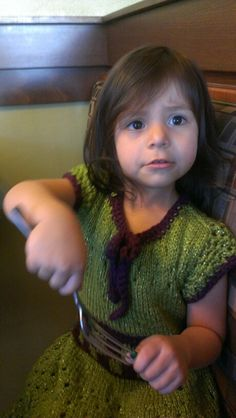 Green knit and crochet swater