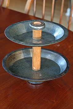 pie tin and wooden spool to make tiered plate