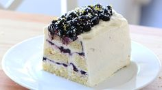Recipe with video instructions: Lemon mascarpone cream and blueberry compote are layered with pound cake to create a beautiful, no-bake dessert! Ingredients: Blueberry Layer:, 3 1/3 cups fresh blueberries, ½ cup sugar, 2 tbsp water, 1 tbsp lemon juice, Lemon Layer:, 226g mascarpone cheese, room temperature, ¾ cup confectioner's sugar, zest from 1 lemon + extra, for topping, 50g white chocolate, grated into fine pieces + extra for topping, 2 cups whipping cream, 1/2 cup lemon curd, ...