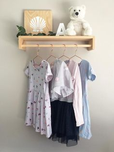 Free Shipping on orders over $200 (Aus only) - Use coupon code FREESHIPPING at checkoutKids Clothes Rack Shelf is made from sustainably sourced Australian Pinewood Measurements: Small: 60cm wide, 10cm high, 17cm deepLarge (not pictured): 80cm wide, 10cm high, 17cm deepTimber is sealed and protected with a satin varnishHas keyhole slots on the back and come with drywall screws/installation instructions for easy & secure hanging*Made for kids hangers, which sit on an angle when hung**Please… Hanging Racks, Hanging Shelves, Diy Hanging, Wooden Clothes Rack, Hanging Clothes, Kids Clothing Rack, Clothing Organization, Bedroom Organization, Diy Clothes Hacks
