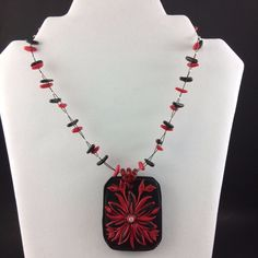 Handmade in Montreal, stunning red and black flower necklace. #fimo
