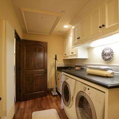 White w/d, White cabinets, dark wood flooring..