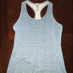 2 ivivva  tanks ( the kid version of lululemon) One baby blue with pocka- dots & One teal tank lululemon athletica Tops Tank Tops