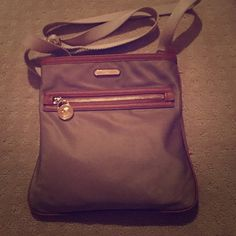 Michael Kors Crossbody Pre-owned, Michael Kors crossbody with gold colored hardware. Purse is still in good used condition. There are some areas of where color of bag has changed some from regular use...possible light transfer of hand lotion or water from a rainy day? Please see photos. All offers will be considered Michael Kors Bags